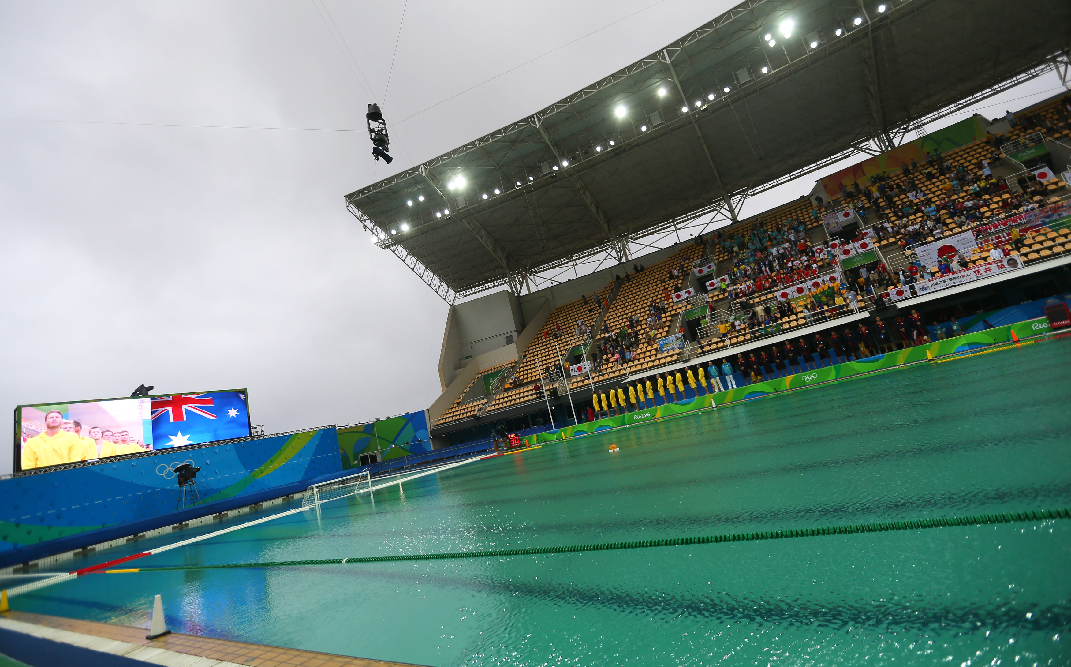 Olympic officials wave white flag in effort to clean green pool ...