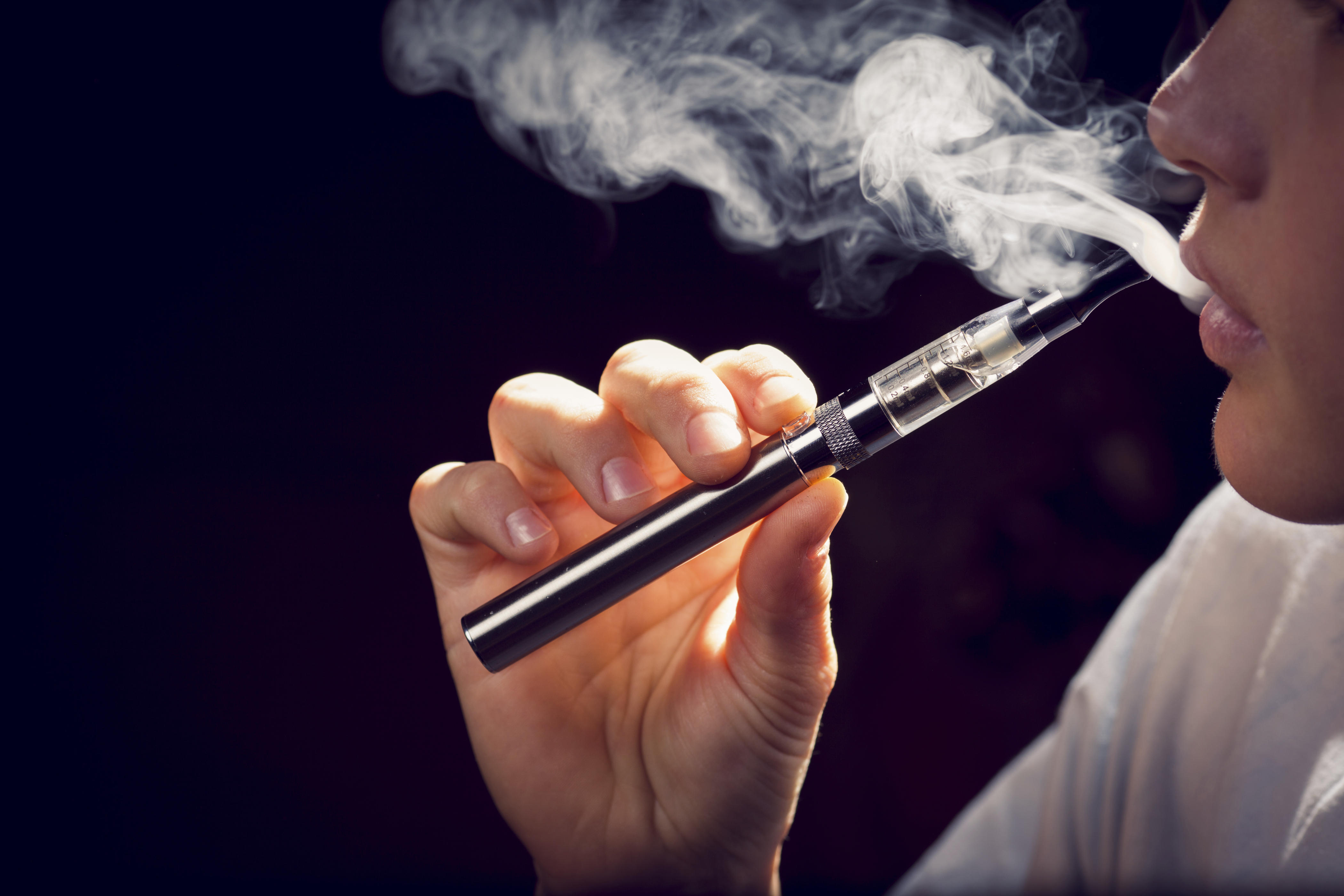 Are e-cigarettes safer than tobacco? New study fires up debate - CBS