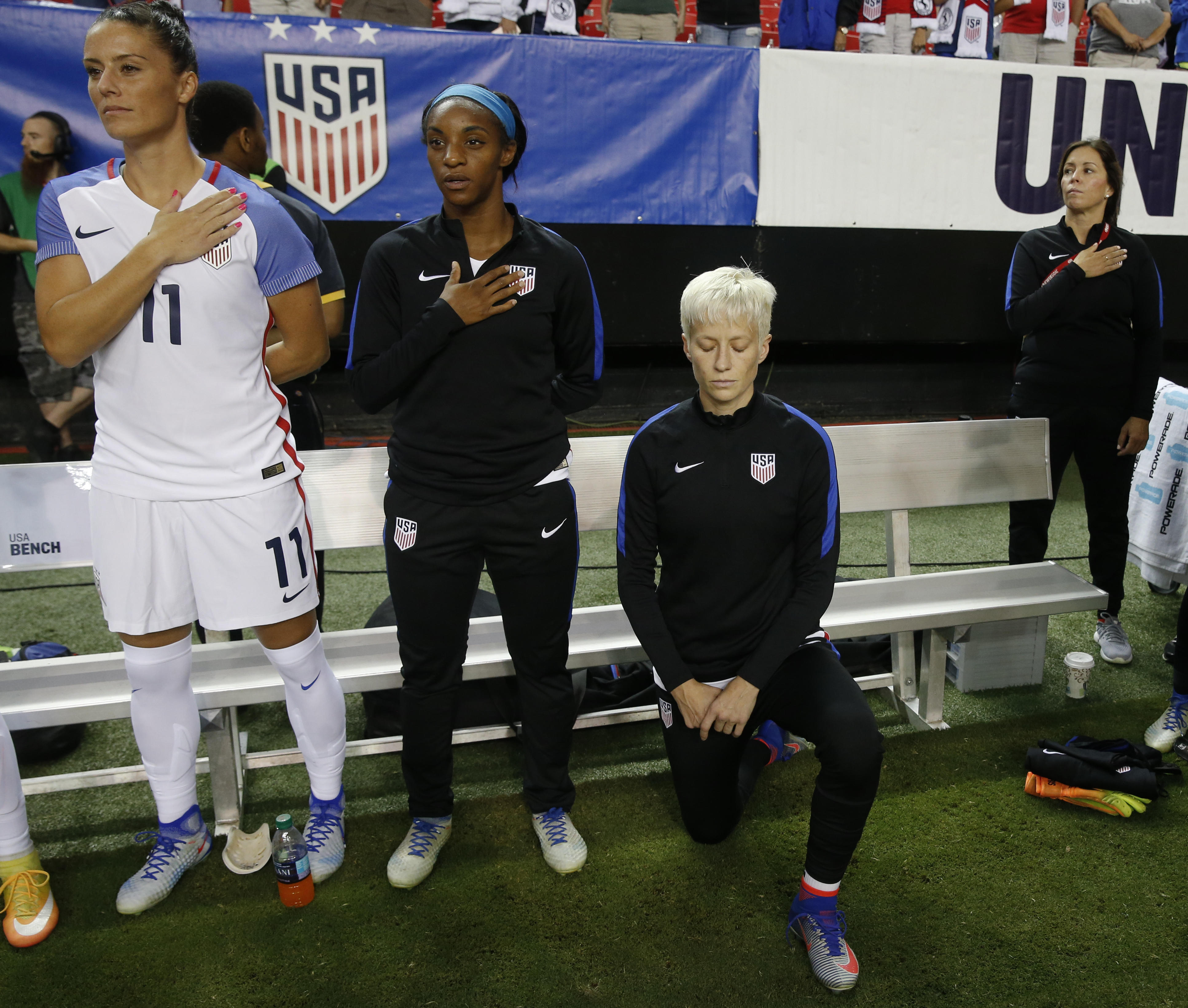 U S  soccer star kneels again during national anthem before game