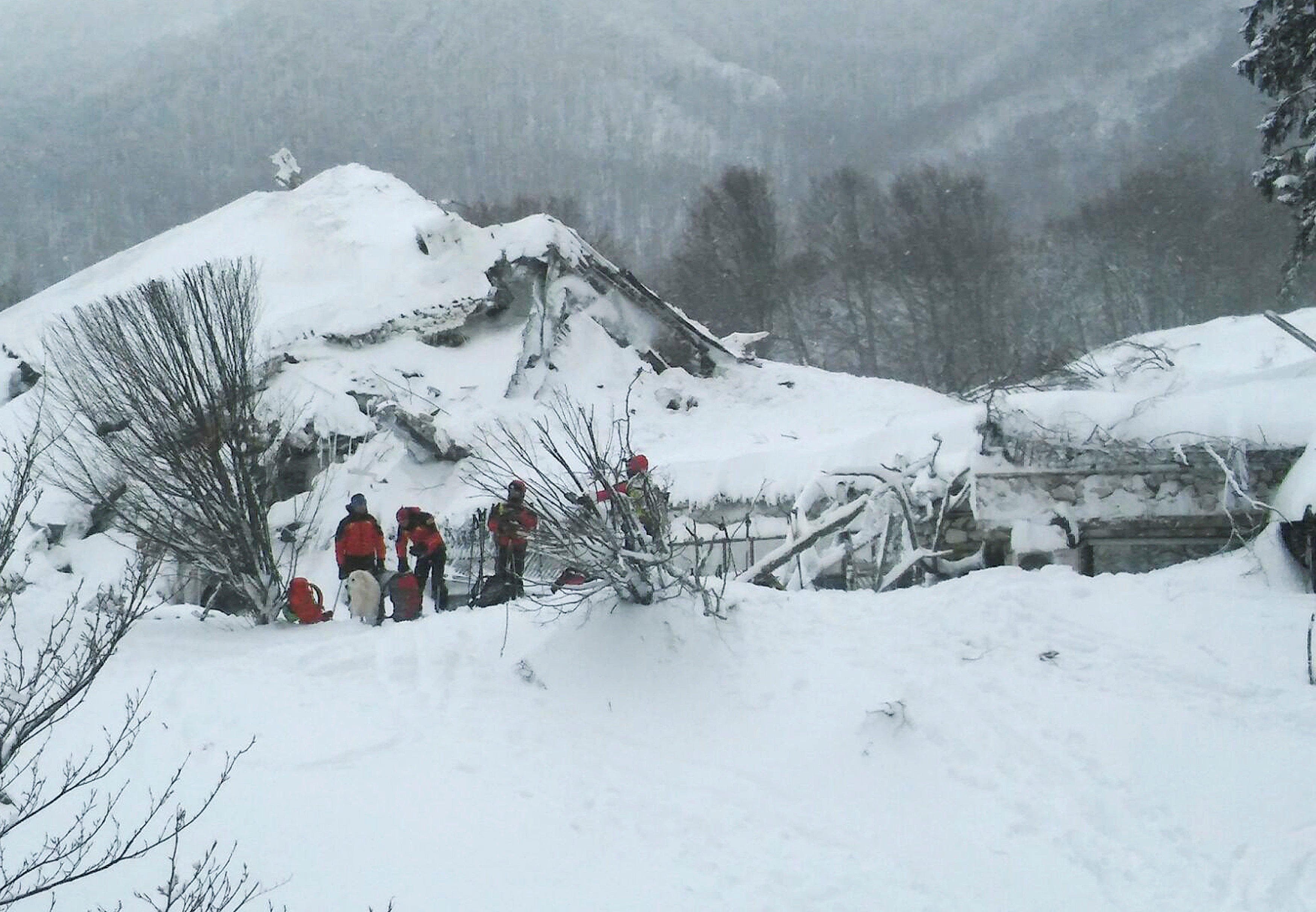 avalanche in italy: crews work through the night in search for