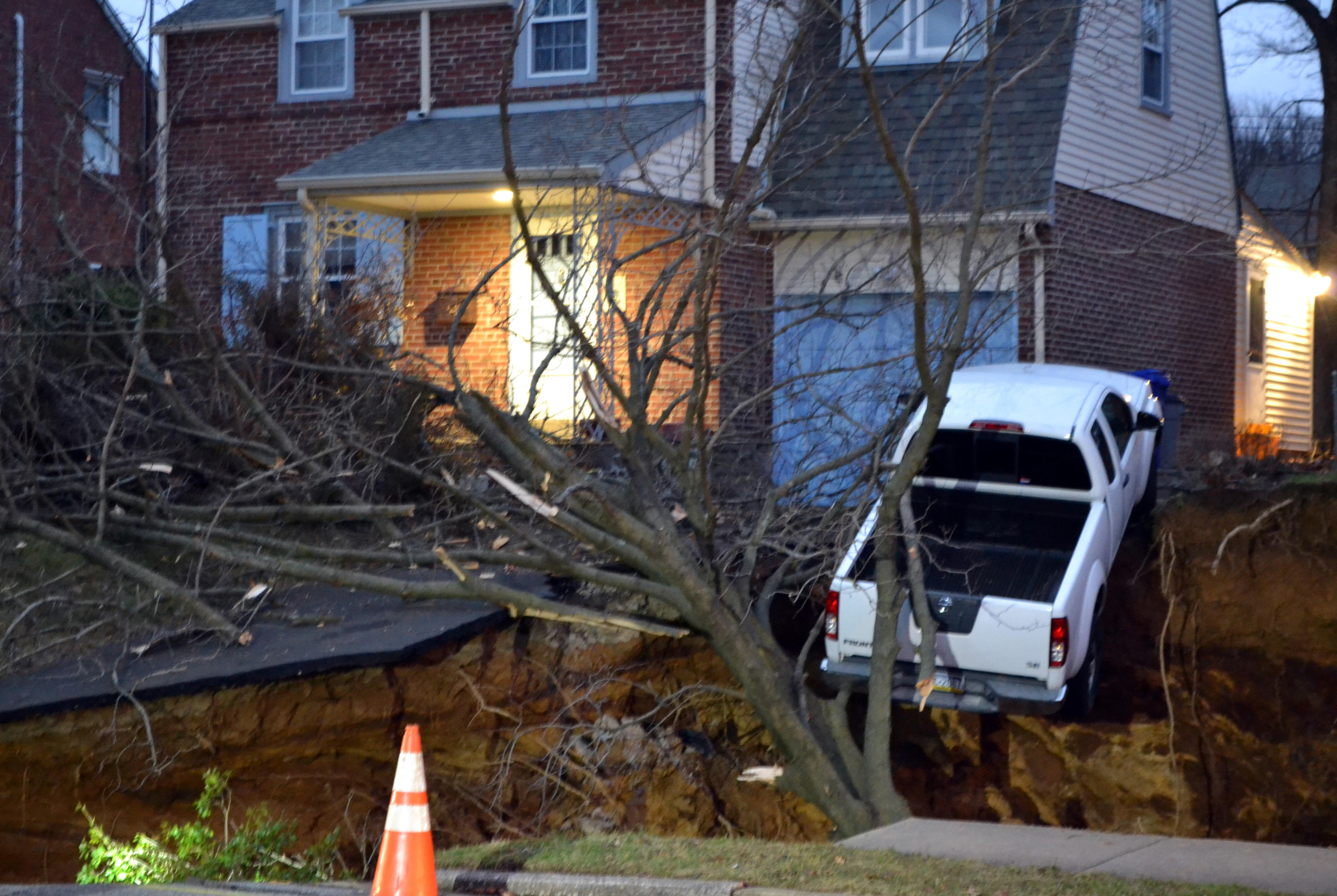 Sinkhole Swallows Yards, Threatens Pickup In Philadelphia