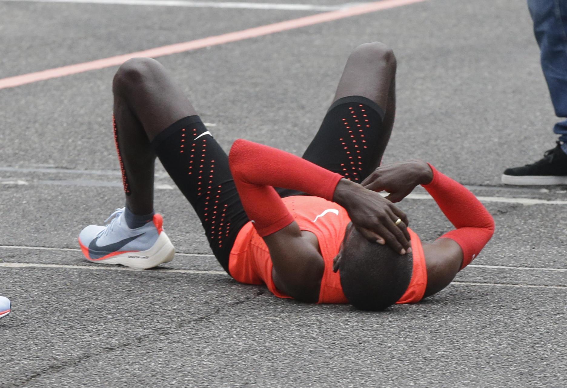 Runner Eliud Kipchoge misses 2-hour marathon milestone by ...