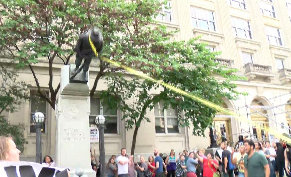 8 now charged in toppling of Durham, N C  Confederate statue