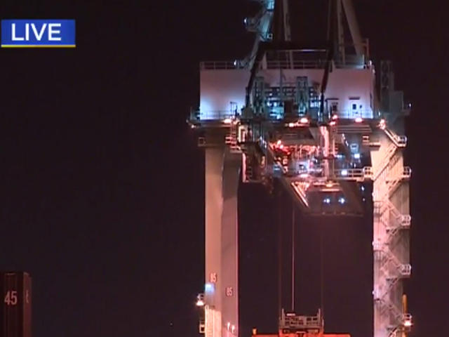 Naked crane climber tumbles seven stories to his death - CBS