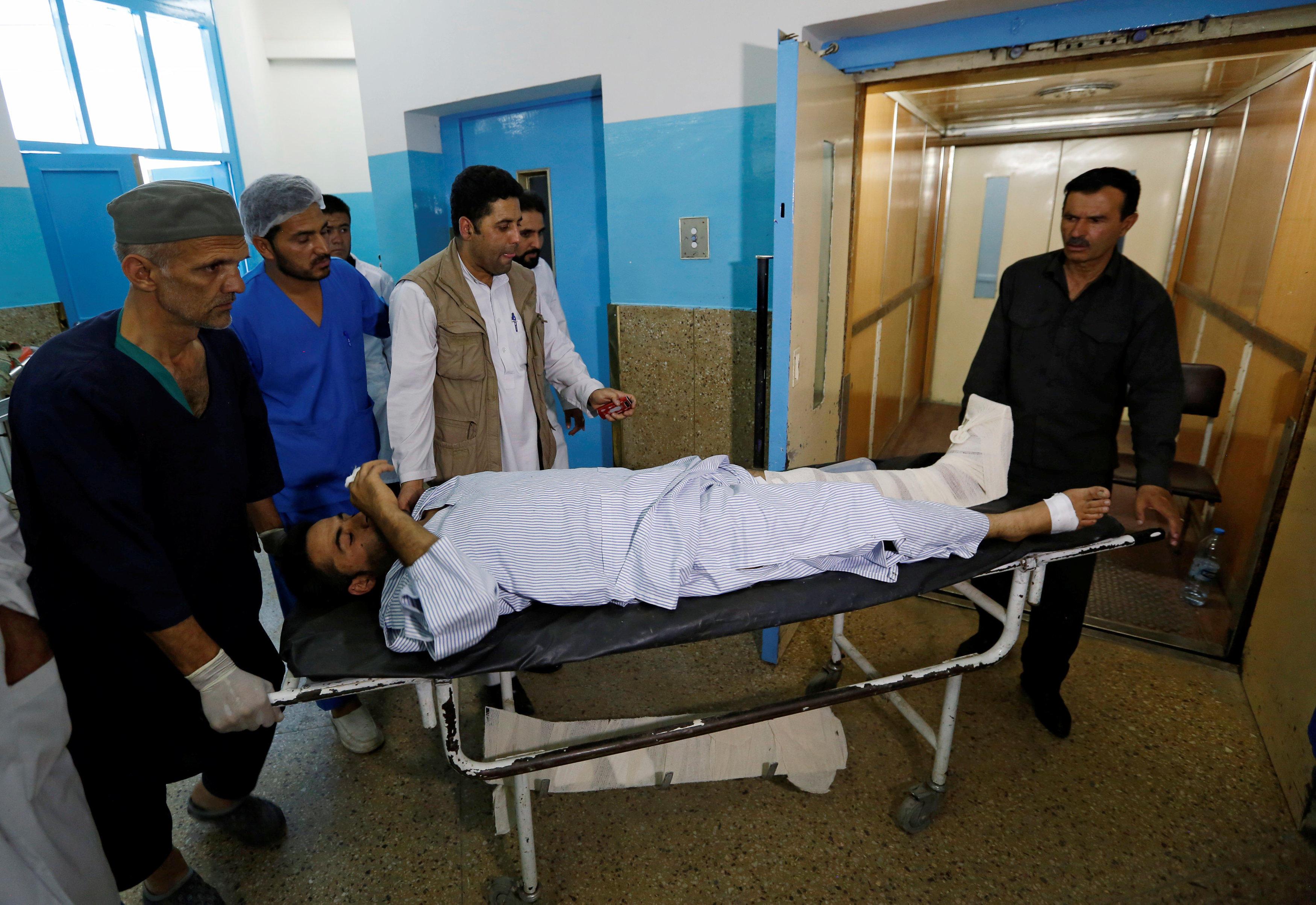 Suicide blast kills at least 5 near bank, U.S. embassy - CBS News