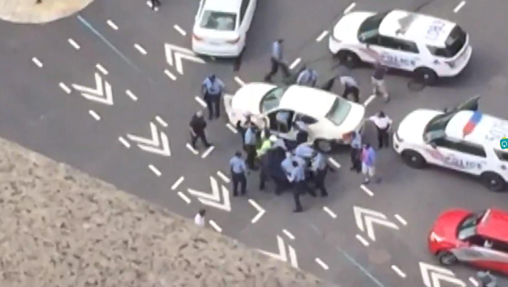 Massive police response after assault suspect crashes car near D.C. Trump hotel