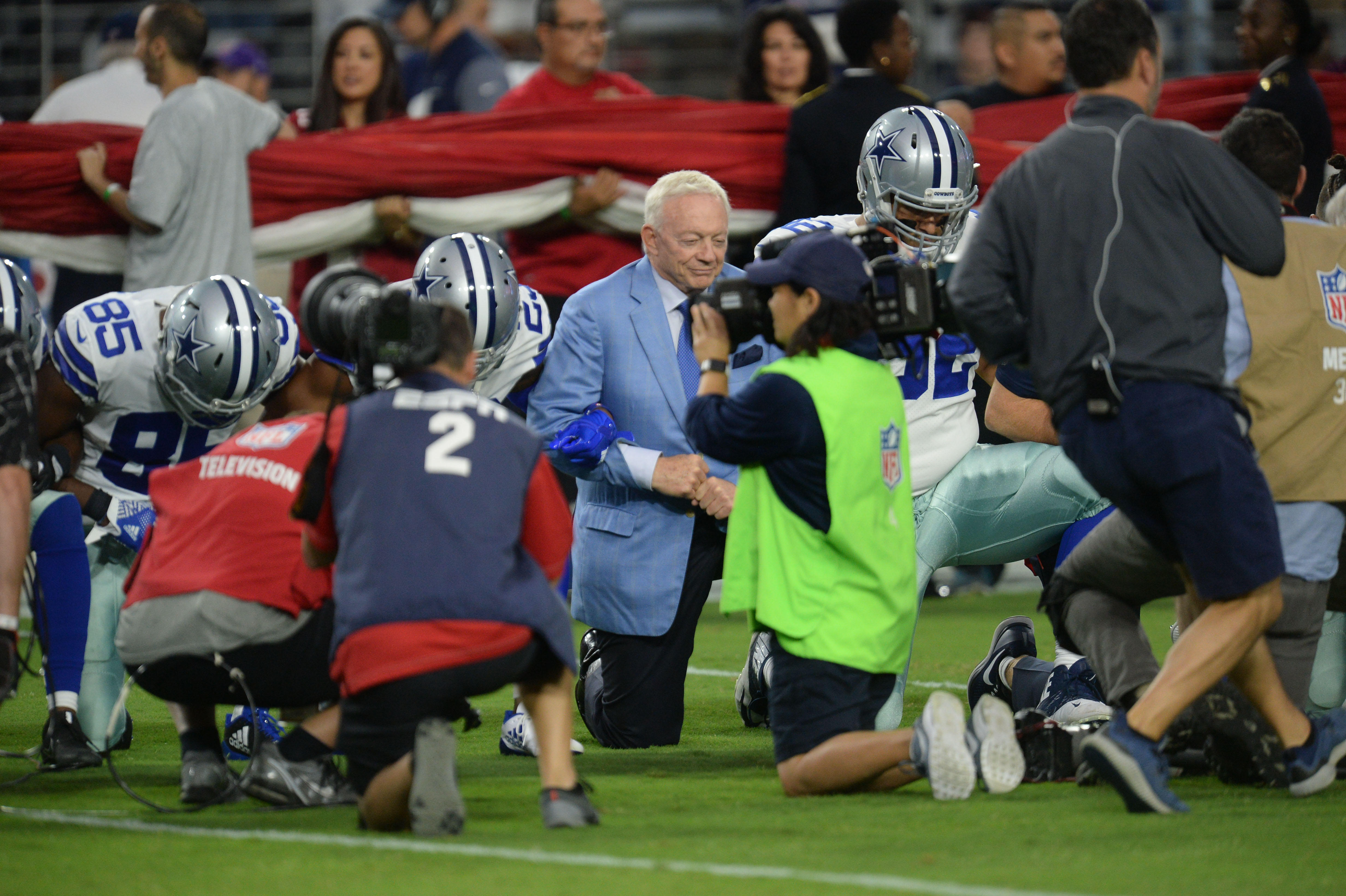 Cowboys owner Jerry Jones kneels with players before national anthem