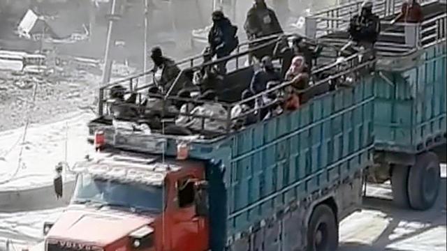 Afbeeldingsresultaat voor IS escape from raqqa green busses