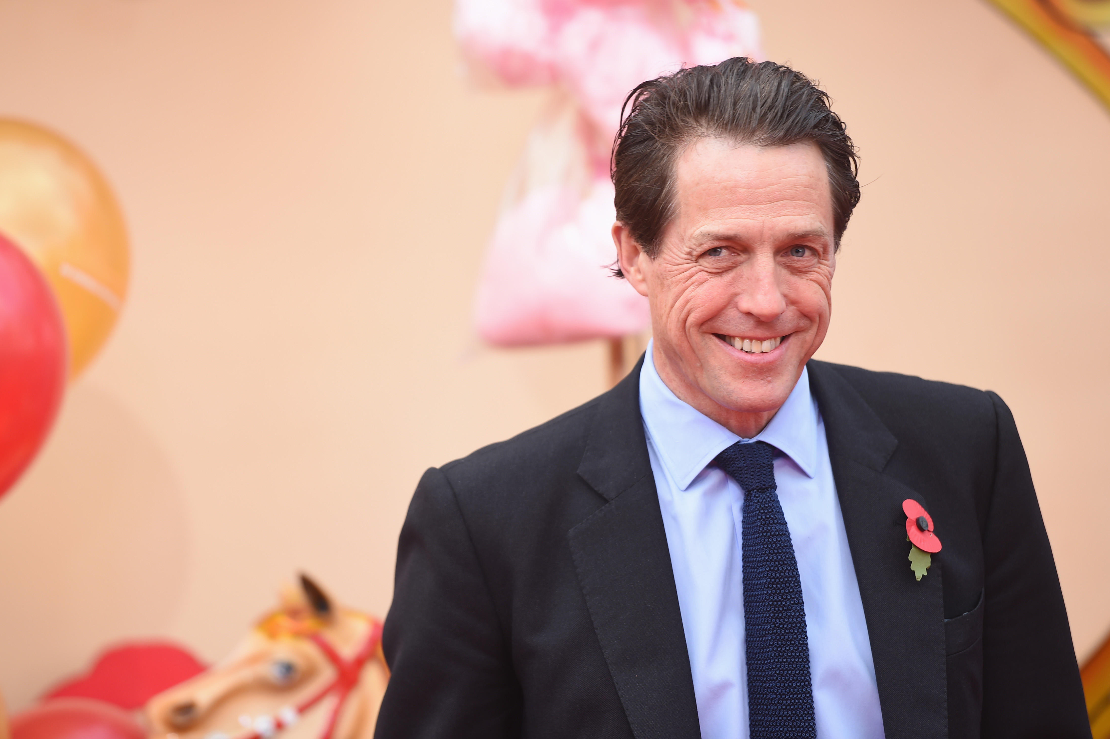 Hugh Grant settles phone-hacking lawsuit against the ...