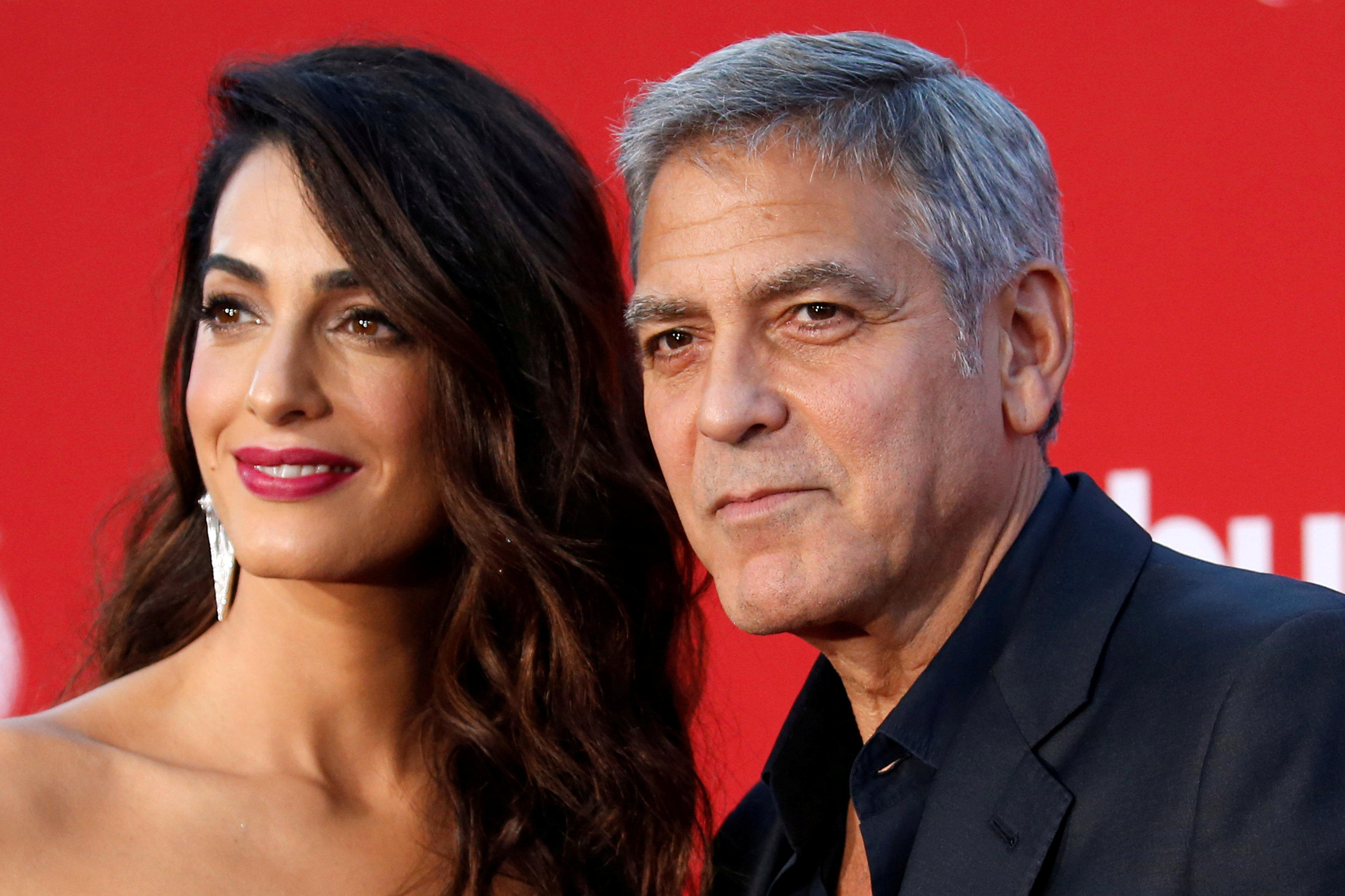 George and Amal Clooney donate $100,000 to aid migrant children, say