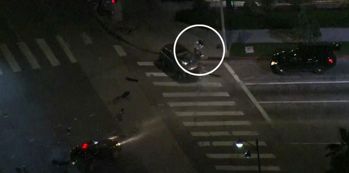 Los Angeles photographer narrowly misses being hit during