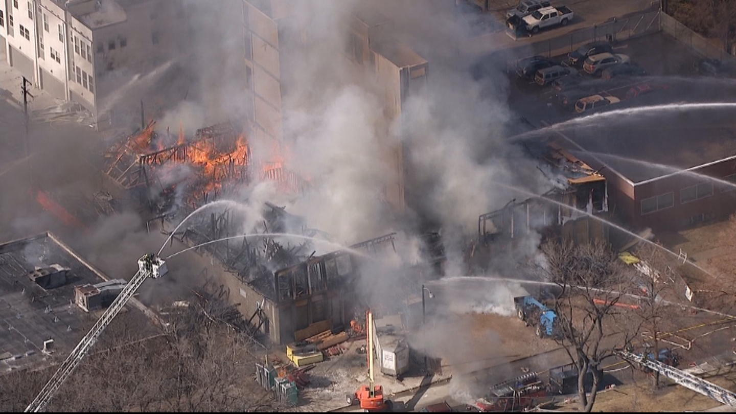 Raging fire at Denver construction site melts nearby cars