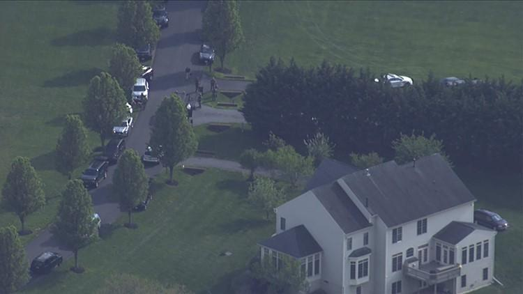 Hostage wife escapes, man kills 3, then self after standoff, police