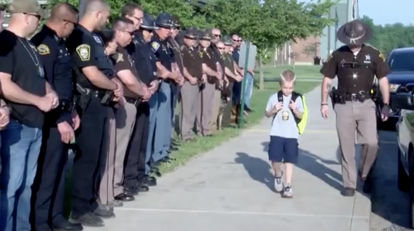 5-year-old boy gets police escort to school after dad dies ...