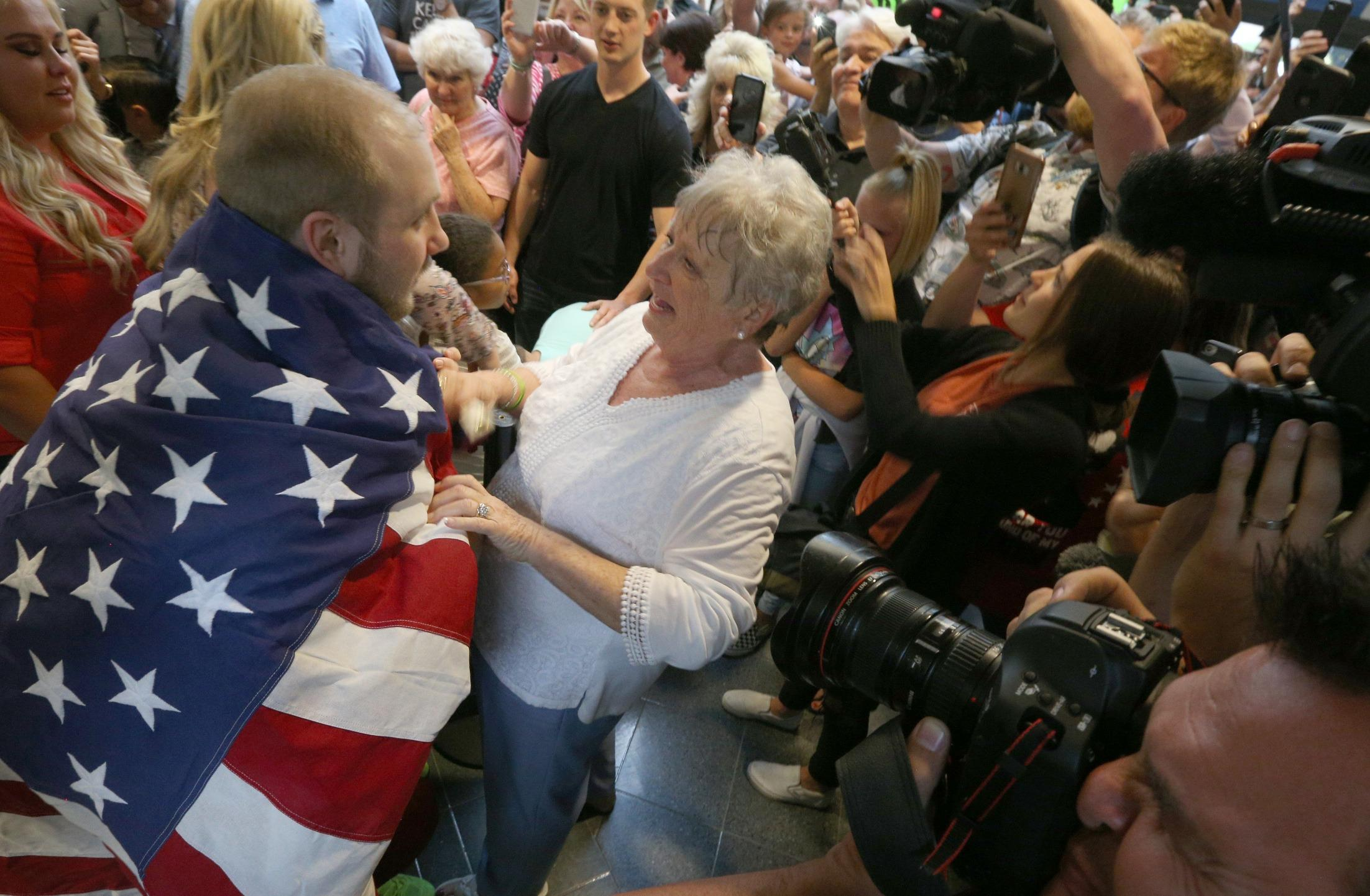7aac4d419 Josh Holt returns home to Utah, days after being freed from Venezuelan  prison