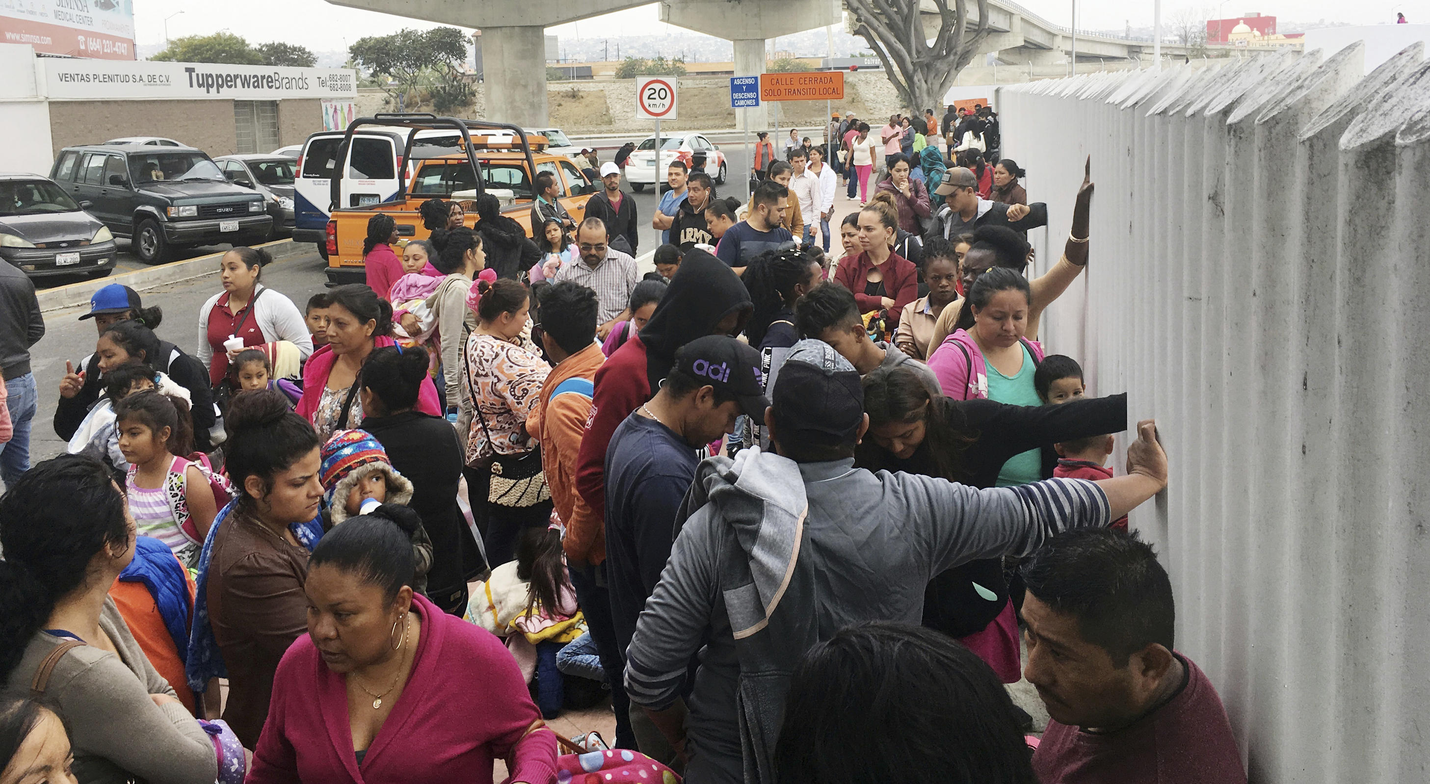Asylum seekers wait days and weeks at U S -Mexico border