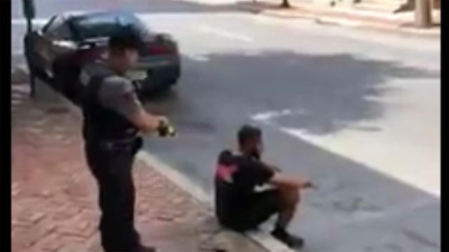 Video shows officer using stun gun on man sitting on sidewalk