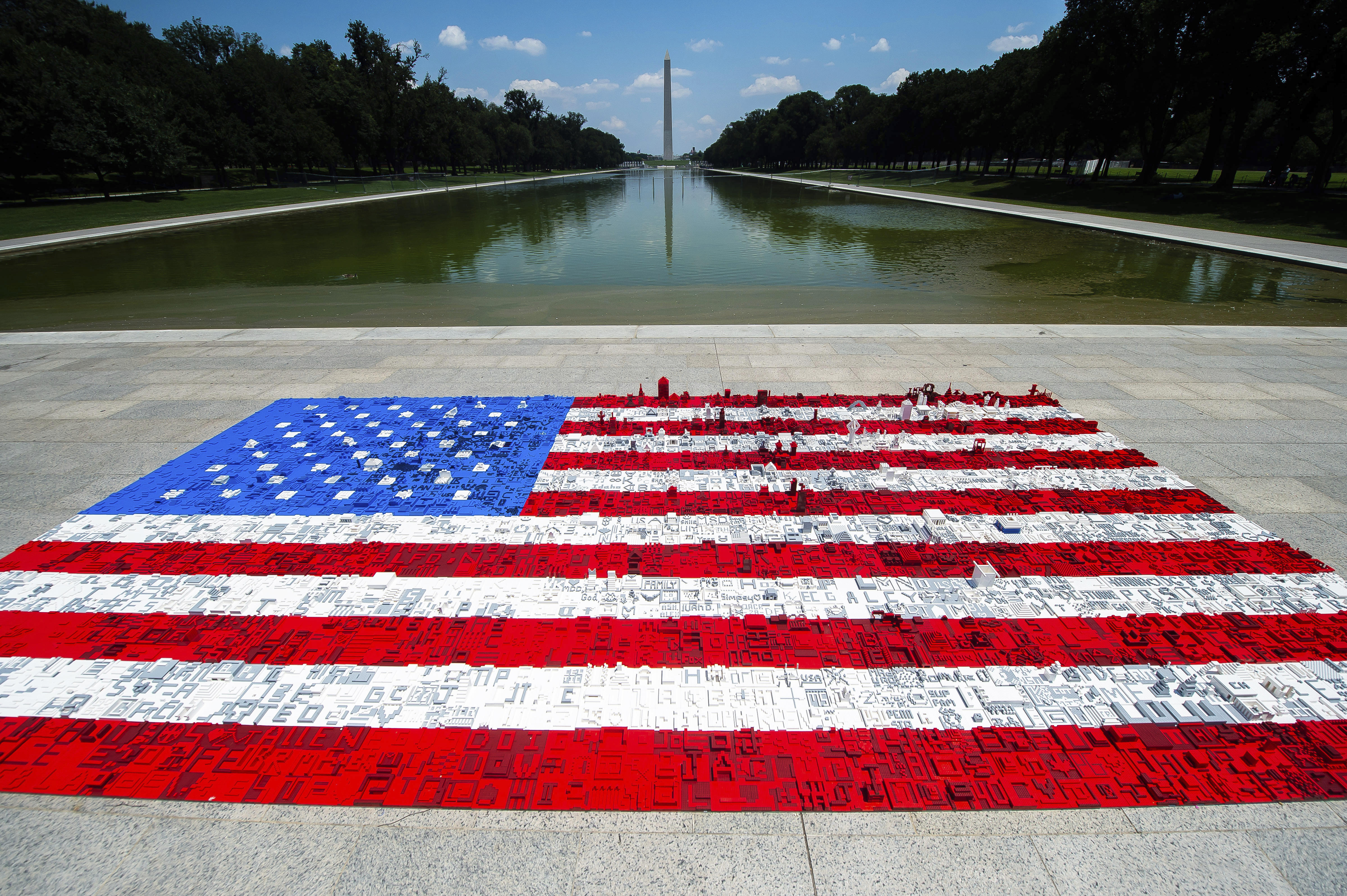 Visitors build giant American flag out of LEGO bricks on the National Mall