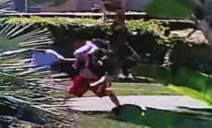 0510f0af0466 Father seen on surveillance camera using baby as a weapon, swinging and  dropping him