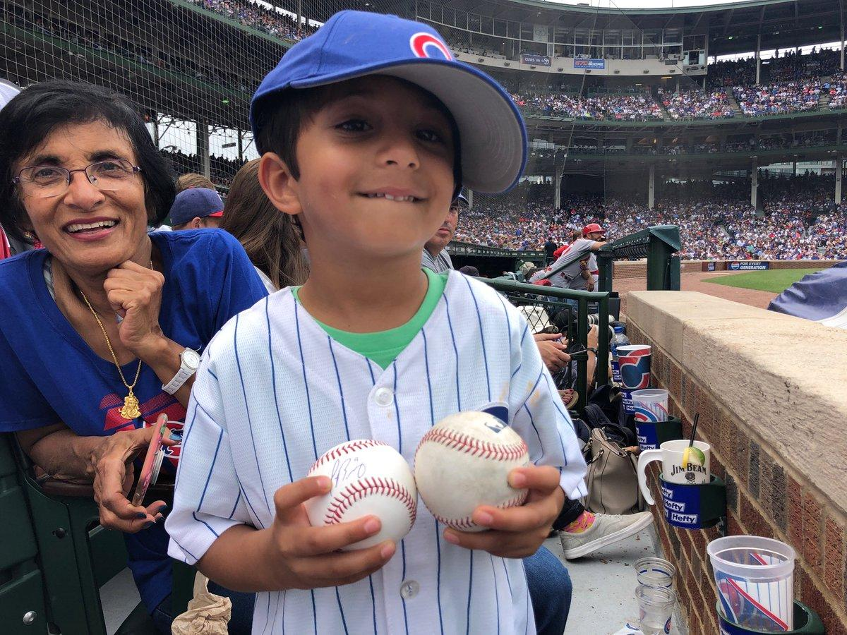 737548de8e7 Fan at MLB game snags foul ball from kid