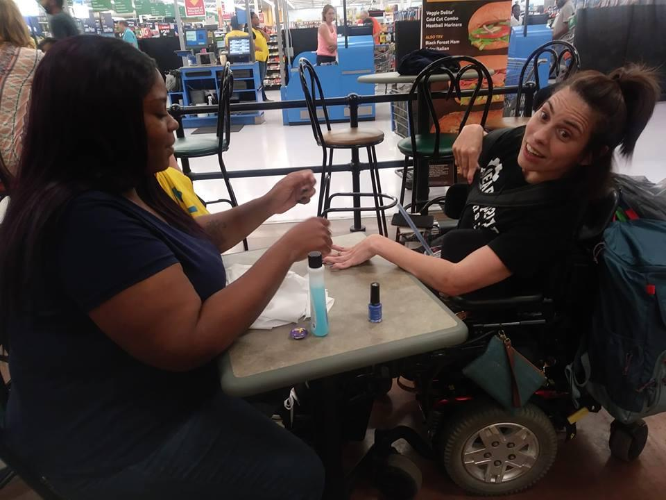 Walmart Employee Uses Break To Paint Nails For Woman With Disability