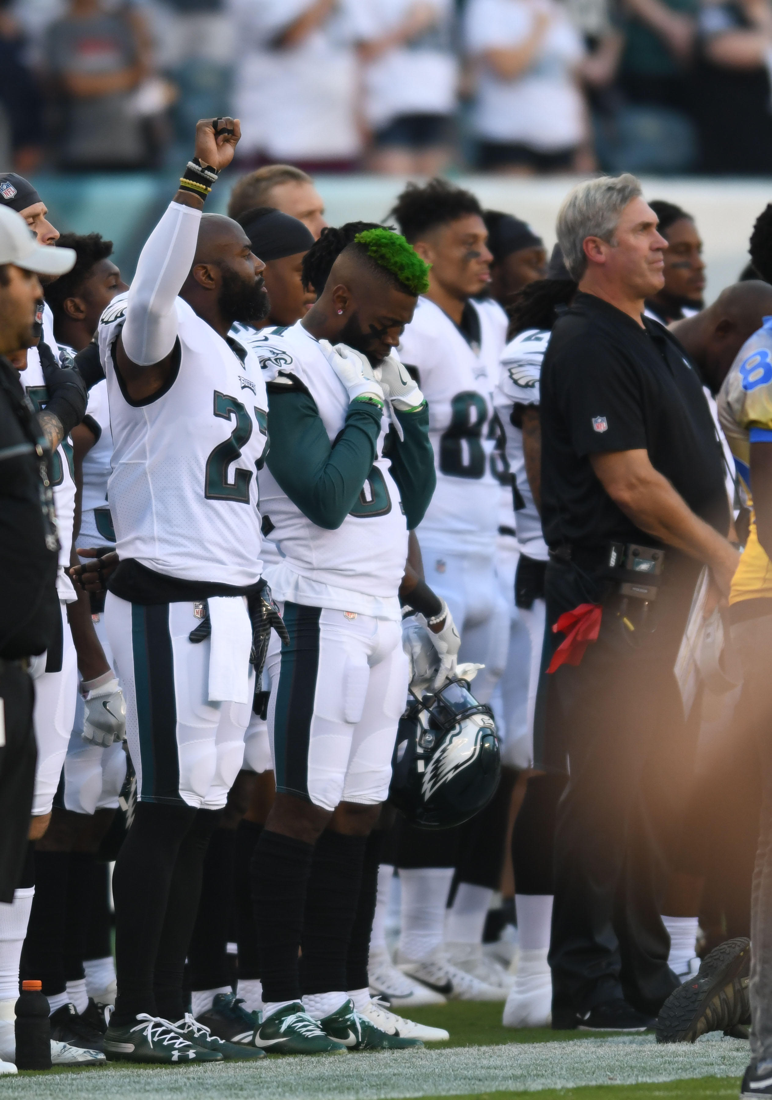 66f7842ae62 NFL players raise fists, kneel and stay off field during national anthem