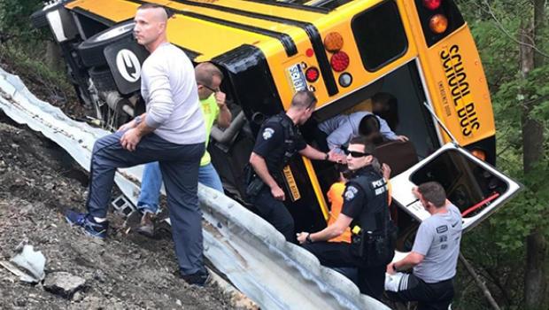 School bus overturns today: More than 2 dozen students
