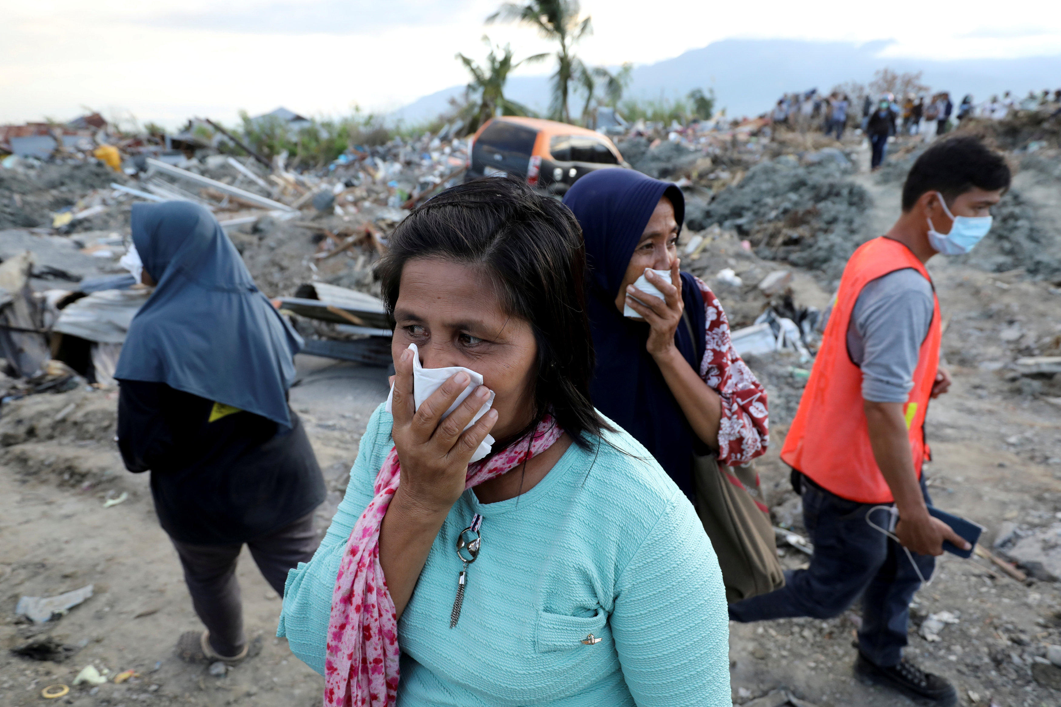 Indonesia earthquake and tsuami death toll nears 2,000, with