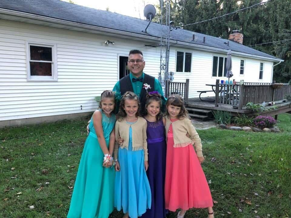 michigan teacher takes two sisters to daddy daughter dance after