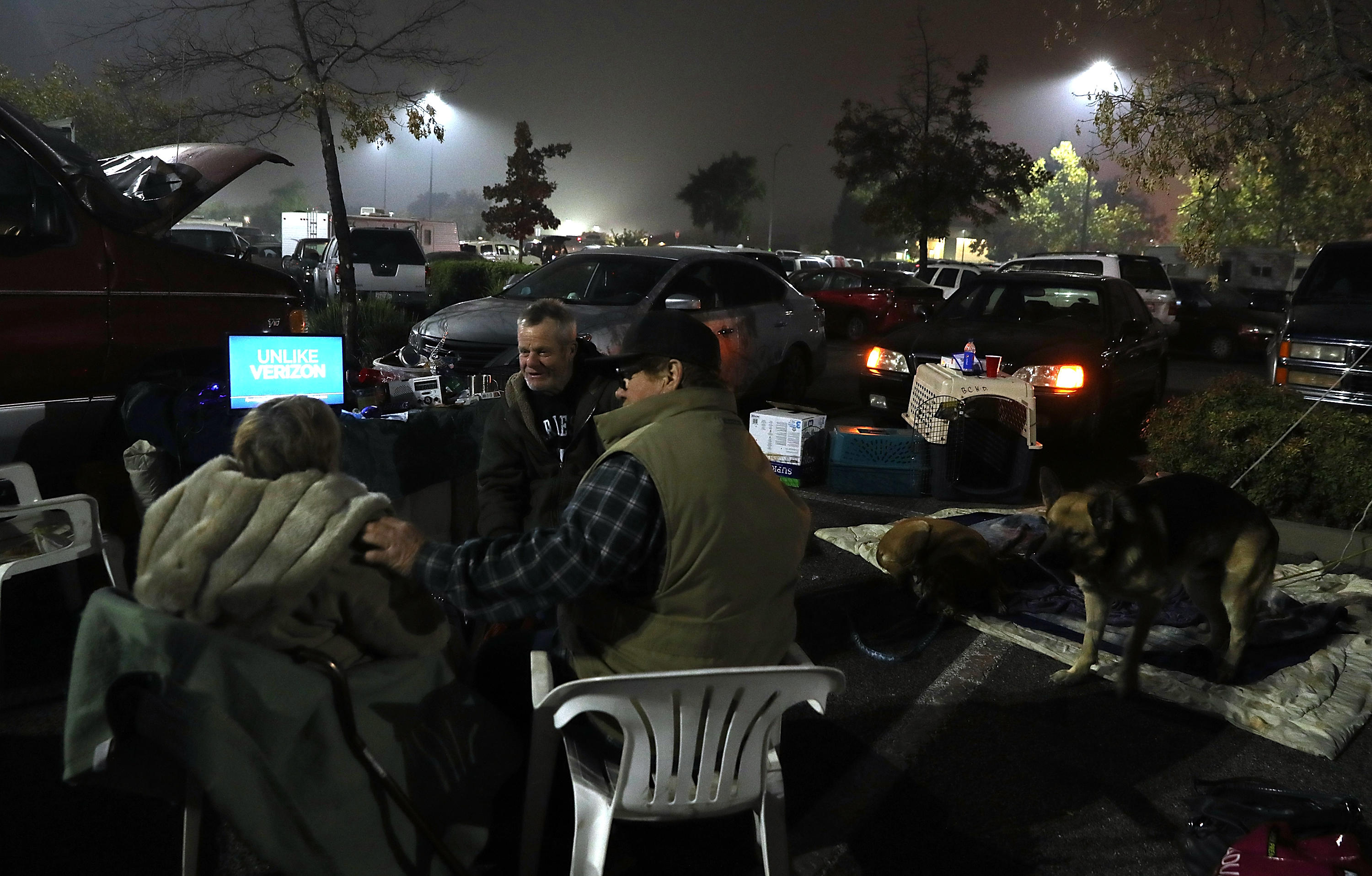 camp fire evacuees at makeshift camp in walmart parking lot in chico