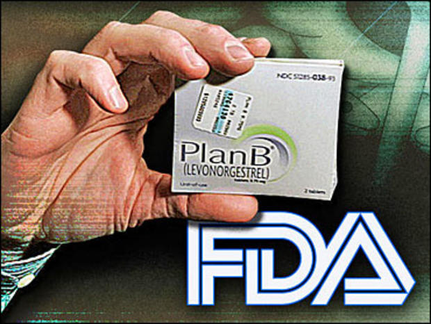 "Pharmacist holds package of ""Plan B"" emergency contraceptive tablets"