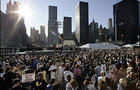 The sun rises over thousands of mourners during a ceremony Monday, Sept. 11, 2006 at the World Trade Center site in New York marking