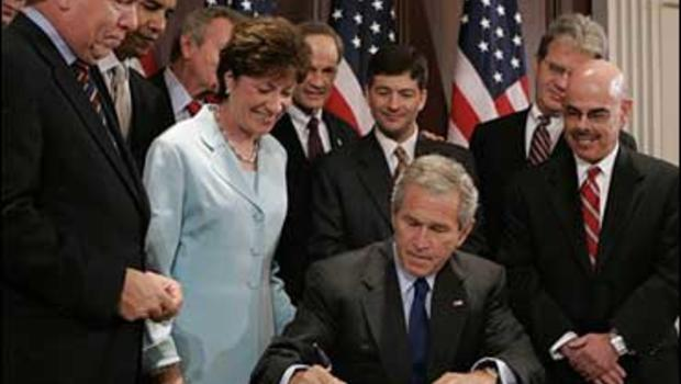 President Bush surrounded by members of Congress signs the Federal Funding Accountability and Transparency Act of 2006, Tuesday, Sept. 26, 2006.