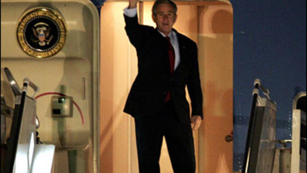 U.S. President George W. Bush waves as he arrives at the Queen Alia International Airport in Amman, Jordan, Wednesday, Nov. 29, 2006.