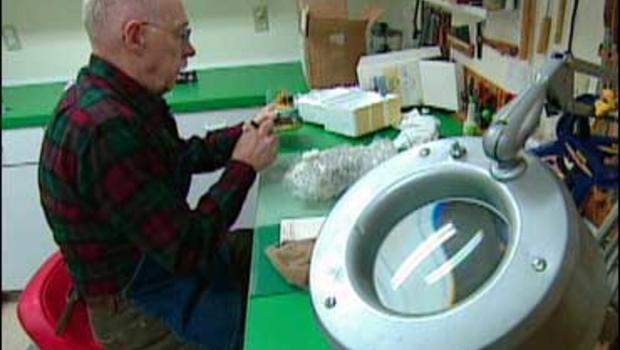 Snow globe repairman Dick Heibel