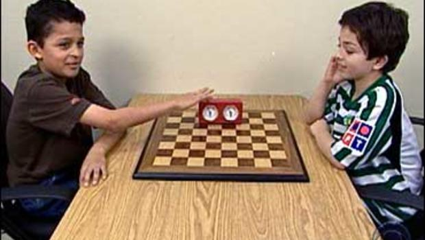 Two young chess players get ready for a challenge.