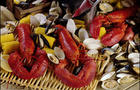 a complete clam bake with lobsters, clams, mussels and corn on the cobb