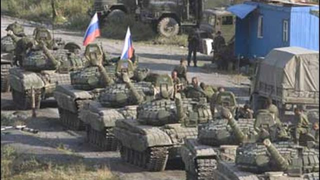 A column of Russian armored vehicles moving in the direction of Russia's North Ossetia, are seen on the outskirts of Tskhinvali