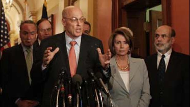 Treasury Secretary Henry Paulson talks with reporters after meeting with Congressional leaders