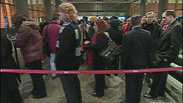 Job seekers wait in line
