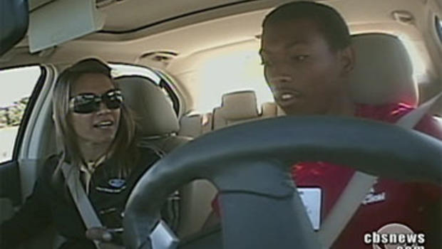 In a driving class, teenager Joseph James attempts to drive and text at the same time.