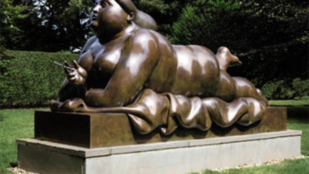 """Mujer Fumando (Smoking Woman),"" a 1987 work by Colombian artist Fernando Botero"