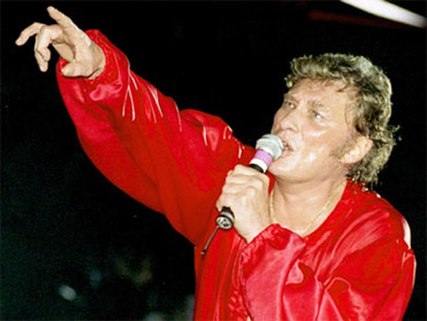 French rock star Johnny Hallyday performs during his 50th birthday concert at the Parc des Princes stadium in Paris, in this June 15, 1993 photo.