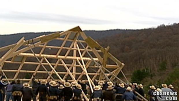 Amish neighbors help John Helmstetter rebuild his barn.