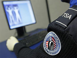 A Transportation Security Administration officer views a full-body scan during a demonstration of passenger screening technology, Wednesday, Dec. 30, 2009, at the TSA Systems Integration Facility in Arlington, Va.
