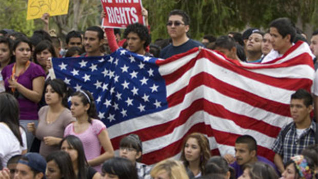 Demonstrators hold a U.S. flag at a protest at the Arizona state Capitol in Phoenix on Thursday, April 22, 2010 against the controversial illegal immigration bill SB1070.