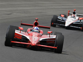 Dario Franchitti, of Scotland, leads Helio Castroneves, of Brazil, early in the race during the Indianapolis 500 auto race at the Indianapolis Motor Speedway in Indianapolis, Sunday, May 30, 2010.