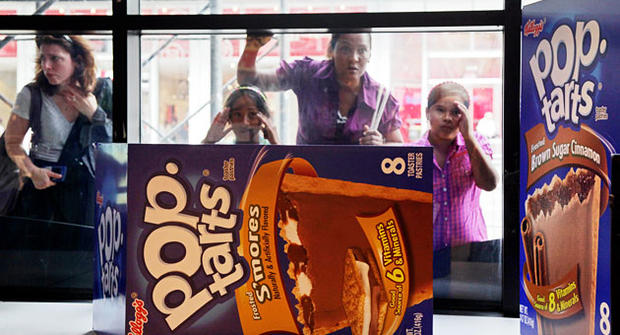 People peer in the window of the Pop-Tarts World store, Monday, Aug. 9, 2010, in New York's Times Square.