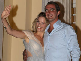 Prince Nikolaos of Greece and his fiancee, Tatiana Blatnik, wave from the steps of the Poseidon Hotel as they attend their pre-wedding reception on Aug. 24, 2010, in Spetses, Greece. (Getty Images)