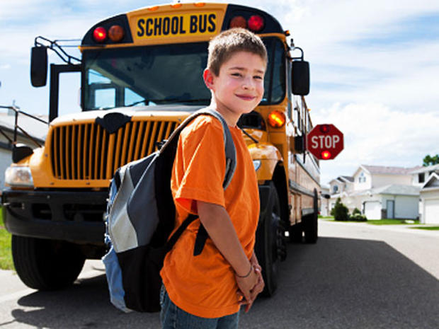 boy-looking-back-school-bus.jpg